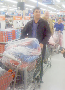 "<div class=""source"">Melinda Thompson</div><div class=""image-desc"">Pictured are members Matt Hopper, Greg Gribbins and Meisha Buck with shopping carts filled with coats to be delivered to the schools.</div><div class=""buy-pic""></div>"