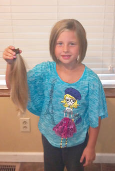 "<div class=""source""></div><div class=""image-desc"">Alexis Knifley of Campbellsville recently donated her hair to Locks of Love. Her hair was cut at Shaggy's Salon.</div><div class=""buy-pic""></div>"