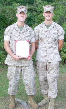 "<div class=""source""></div><div class=""image-desc"">Kyle Butzer, formerly of Lebanon, left, was recently promoted to E-5 at Camp Lejeune Marine Base, N.C. His brother, Andrew Butzer, right, also a Marine at Camp Lejeune, was present to pin on his Chevrons. Attending the ceremony were his wife and daughter,</div><div class=""buy-pic""><a href=""http://web2.lcni5.com/cgi-bin/c2newbuyphoto.cgi?pub=085&orig=Kyle%2BButzer.jpg"" target=""_new"">Buy this photo</a></div>"