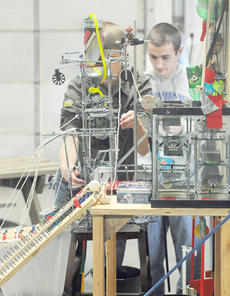 "<div class=""source""></div><div class=""image-desc"">Lindsey Wilson College Area Rube Goldberg Experience member Christopher Force of Campbellsville, left, and Jacob Johnson of Elk Horn, make adjustments to their machine before demonstrating it to Taylor County High School students. </div><div class=""buy-pic""></div>"