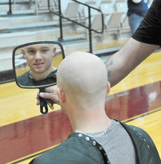 "<div class=""source"">Richard RoBards</div><div class=""image-desc"">Lance Riddle takes a look at his shaven head.</div><div class=""buy-pic""></div>"
