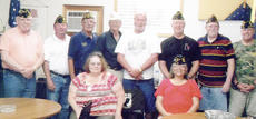 "<div class=""source""></div><div class=""image-desc"">American Legion Post 82 recently elected new officers. They are, from left, front, Laurie Mandi, public relations; and Sylvia Young, chaplain. Back, Bobby Baker, service officer; Greg Collins, first vice president; Phil Davis, commander; Robert Bryant, membership; Ron Milby, judge advisor; Mike Dishman, second vice president; Steve Orr, finance; and Greg Parent, sergeant at arms.</div><div class=""buy-pic""></div>"