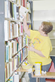 "<div class=""source"">Calen McKinney</div><div class=""image-desc"">Circulation clerk Cheri Ramsey cleans and organizes books at the Taylor County Public Library in preparation for them to move to the new library on East Broadway.</div><div class=""buy-pic""><a href=""/photo_select/42535"">Buy this photo</a></div>"