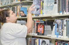 "<div class=""source"">Calen McKinney</div><div class=""image-desc"">Circulation Clerk Sarah Hampton organizes books that will be moved to the new Taylor County Public Library on East Broadway.</div><div class=""buy-pic""><a href=""/photo_select/42534"">Buy this photo</a></div>"