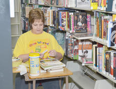 "<div class=""source"">Calen McKinney</div><div class=""image-desc"">Circulation clerk Cheri Ramsey cleans and organizes books at the Taylor County Public Library in preparation for them to move to the new library on East Broadway.</div><div class=""buy-pic""><a href=""/photo_select/42533"">Buy this photo</a></div>"