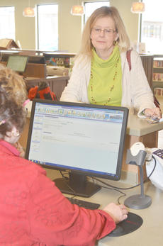 """<div class=""""source"""">Calen McKinney</div><div class=""""image-desc"""">Elise Mohon of Campbellsville, gets her new library card during the official opening day of the Taylor County Public Library last Wednesday from Circulation Specialist Cheri Ramsey.</div><div class=""""buy-pic""""><a href=""""/photo_select/43337"""">Buy this photo</a></div>"""