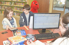 """<div class=""""source"""">Calen McKinney</div><div class=""""image-desc"""">Kate Billeter, 5, and her brother, Isaac, 6, of Campbellsville, check out books at the library with Youth Services Librarian Emily Snyder last Wednesday. The new Taylor County Public Library officially opened its doors to the public that day.</div><div class=""""buy-pic""""><a href=""""/photo_select/43332"""">Buy this photo</a></div>"""