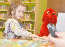 """<div class=""""source"""">Calen McKinney</div><div class=""""image-desc"""">Kate Billeter, 5, of Campbellsville, packs up her books as Emily Snyder, youth services librarian at the Taylor County Public Library, checks them out for her last Wednesday. The new library officially opened its doors to the public that day.</div><div class=""""buy-pic""""><a href=""""/photo_select/43333"""">Buy this photo</a></div>"""