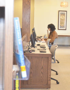 """<div class=""""source"""">Calen McKinney</div><div class=""""image-desc"""">Tempest Campbell of Campbellsville uses a public computer terminal at the Taylor County Public Library last Wednesday, the day it officially opened to the public.</div><div class=""""buy-pic""""><a href=""""/photo_select/43336"""">Buy this photo</a></div>"""
