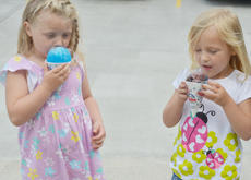 """<div class=""""source"""">Calen McKinney</div><div class=""""image-desc"""">Myleah Read, 4, at left, and Addison Fulkerson, 4, of Campbellsville, take big bites of their snow cones.</div><div class=""""buy-pic""""><a href=""""/photo_select/45241"""">Buy this photo</a></div>"""