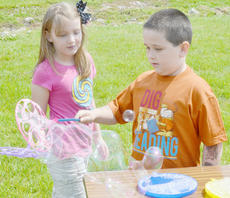 """<div class=""""source"""">Calen McKinney</div><div class=""""image-desc"""">Penny Holland, 8, and Miles Wright, 7, both of Campbellsville, play with bubbles.</div><div class=""""buy-pic""""><a href=""""/photo_select/45243"""">Buy this photo</a></div>"""