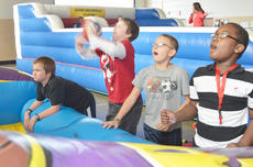 """<div class=""""source"""">Calen McKinney</div><div class=""""image-desc"""">Students gasp as some of their basketballs go in the hoop and others fall short.</div><div class=""""buy-pic""""><a href=""""/photo_select/40856"""">Buy this photo</a></div>"""