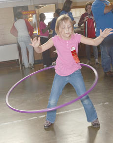 """<div class=""""source"""">Calen McKinney</div><div class=""""image-desc"""">Taylor County Middle School student Autumn Walters twirls a hula-hoop.</div><div class=""""buy-pic""""><a href=""""/photo_select/40857"""">Buy this photo</a></div>"""