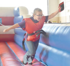 """<div class=""""source"""">Calen McKinney</div><div class=""""image-desc"""">Campbellsville Middle School student Piper Rucker stretches to place her beanbag farther than her opponent.</div><div class=""""buy-pic""""><a href=""""/photo_select/40859"""">Buy this photo</a></div>"""