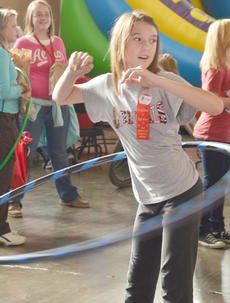 """<div class=""""source"""">Calen McKinney</div><div class=""""image-desc"""">Taylor County Elementary School student Ashton Anderson twirls her hula-hoop.</div><div class=""""buy-pic""""><a href=""""/photo_select/40863"""">Buy this photo</a></div>"""