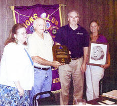 "<div class=""source""></div><div class=""image-desc"">Club president Shelia Wethington, at left, and secretary Mel Gilbert, second from left, presented the Melvin Jones Fellowship award to club member Ricky Sparkman, third from left. Club member Terri Halliwell, at right, zone chairperson from Jamestown, was presented a framed Lion print for her service representing the zone clubs in Lions District 43-C.</div><div class=""buy-pic""></div>"