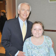 """<div class=""""source""""></div><div class=""""image-desc"""">Bella Long, a third-grade student at Taylor County Elementary School, recently won second place in the state's Dr. Martin Luther King Jr. Moving Beyond the Dream visual arts contest. Long is pictured with Kentucky Gov. Steve Beshear. </div><div class=""""buy-pic""""></div>"""