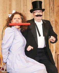 """<div class=""""source"""">Stephen Lega</div><div class=""""image-desc"""">Amy Lovely, portrayed by Stevie Lowery, falls victim to the dastardly Fillmore Filcher, played by Lynn Farris, after refusing to sell her family property, the Lovely Ranch, to him. </div><div class=""""buy-pic""""></div>"""
