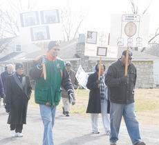 "<div class=""source"">Calen McKinney</div><div class=""image-desc"">Many marchers held signs with photos of King.</div><div class=""buy-pic""><a href=""/photo_select/35137"">Buy this photo</a></div>"