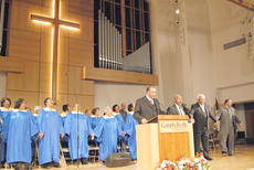 "<div class=""source"">Calen McKinney</div><div class=""image-desc"">Sunday's worship service ended with a singing of ""We Shall Overcome,"" while the crowd held hands.</div><div class=""buy-pic""><a href=""/photo_select/35139"">Buy this photo</a></div>"