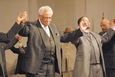 "<div class=""source"">Calen McKinney</div><div class=""image-desc"">Sunday's worship service ended with a singing of ""We Shall Overcome,"" while the crowd held hands.</div><div class=""buy-pic""><a href=""http://web2.lcni5.com/cgi-bin/c2newbuyphoto.cgi?pub=085&orig=MLK%2BWorship%2BService%2B7.jpg"" target=""_new"">Buy this photo</a></div>"