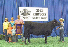 "<div class=""source""></div><div class=""image-desc"">Tanner Martin, at right, with Johnson Salers Farm, won Kentucky Grand Champion Salers Heifer with Miss Cowgirl at the 2012 Kentucky State Fair. Pictured with Martin are his parents, Josh and Chasity Johnson, sisters Shelby and Ashton and brother Jacob. He is the grandson of Susan Seaborne of Campbellsville. </div><div class=""buy-pic""></div>"