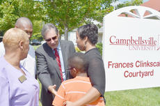 """<div class=""""source"""">Calen McKinney</div><div class=""""image-desc"""">Former U.S. Rep. Ron Lewis, who was a close friend of Frances Clinkscales, meets her family members at Campbellsville University last Thursday after a courtyard was dedicated in her honor. Clinkscales worked with Lewis to secure grant funding for the CU School of Nursing, which was dear to Clinkscales.</div><div class=""""buy-pic""""><a href=""""/photo_select/40110"""">Buy this photo</a></div>"""