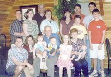 "<div class=""source""></div><div class=""image-desc"">From left, front, are Joshua and Beth Jude Munford, Pat Moore, holding Katie Munford and Zachary Gabbert, Olivia Newton, Barbara Moore, holding Caleb Munford, Samuel Newton and Josh Newton. Back row, David and Jessica Jude Gabbert, Calvin and Tammy Jude, Lana and Mark Newton and John Newton. </div><div class=""buy-pic""></div>"
