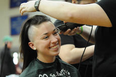 "<div class=""source"">Richard RoBards</div><div class=""image-desc"">Morgan Wilson of Campbellsville, a soccer player at Campbellsville University, shaved her head on Saturday. Wilson's grandfather was diagnosed with cancer in January and died three weeks ago.</div><div class=""buy-pic""></div>"