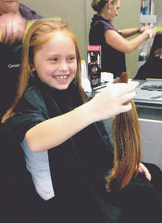 "<div class=""source""></div><div class=""image-desc"">Brooklyn Morris, 7, recently donated 10 inches of her hair to the Locks of Love program.</div><div class=""buy-pic""></div>"