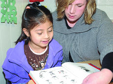 """<div class=""""source"""">James Roberts</div><div class=""""image-desc"""">Karen Ramos-Diaz, a student at Taylor County Elementary School, reads with ESL Teacher Shannon Cox. Karen, a first grader, has been at TCES since pre-school and has limited English proficiency.</div><div class=""""buy-pic""""><a href=""""/photo_select/19567"""">Buy this photo</a></div>"""
