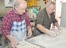 """<div class=""""source"""">Calen McKinney</div><div class=""""image-desc"""">Paul Hardesty, at left, and his father-in-law, Orville Newton, make biscuits on Saturday morning.</div><div class=""""buy-pic""""><a href=""""/photo_select/43544"""">Buy this photo</a></div>"""