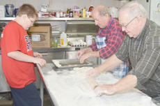 """<div class=""""source"""">Calen McKinney</div><div class=""""image-desc"""">Paul Hardesty, at left, and his father-in-law, Orville Newton, make biscuits on Saturday morning, while Brady Cook, Newton's great-grandson, watches.</div><div class=""""buy-pic""""><a href=""""/photo_select/43548"""">Buy this photo</a></div>"""