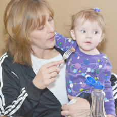 """<div class=""""source"""">Calen McKinney</div><div class=""""image-desc"""">Rhonda Watson holds Alexis Hoosier, 1, while she eats her last breakfast at Orville's.</div><div class=""""buy-pic""""><a href=""""/photo_select/43549"""">Buy this photo</a></div>"""