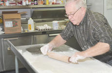 """<div class=""""source"""">Calen McKinney</div><div class=""""image-desc"""">Orville Newton makes his sought-after homemade biscuits. He says he has likely made """"a million"""" of them and might take home one of the tables on which he made the biscuits. """"I might take one with me,"""" Newton said. """"There's just something about homemade like that.""""</div><div class=""""buy-pic""""><a href=""""/photo_select/43537"""">Buy this photo</a></div>"""