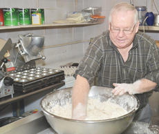 """<div class=""""source"""">Calen McKinney</div><div class=""""image-desc"""">Orville Newton makes his sought-after homemade biscuits. He says he has likely made """"a million"""" of them and might take home one of the tables on which he made the biscuits. """"I might take one with me,"""" Newton said. """"There's just something about homemade like that.""""</div><div class=""""buy-pic""""><a href=""""/photo_select/43542"""">Buy this photo</a></div>"""