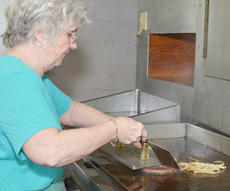 """<div class=""""source"""">Calen McKinney</div><div class=""""image-desc"""">Rena Newton cooks a hamburger for one of her last customers. Orville's Family Restaurant, which Newton and her husband, Orville, have owned since 1978, closed on Saturday.</div><div class=""""buy-pic""""><a href=""""/photo_select/43543"""">Buy this photo</a></div>"""