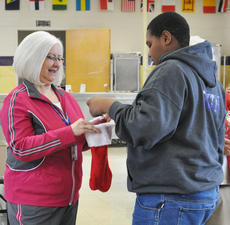 """<div class=""""source"""">James Roberts</div><div class=""""image-desc"""">Antonio Smith draws for a prize from a stocking held by Campbellsville Independent School Board Chair member Pat Hall.</div><div class=""""buy-pic""""><a href=""""/photo_select/26752"""">Buy this photo</a></div>"""