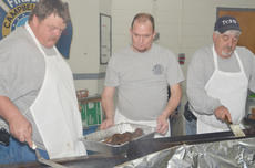 """<div class=""""source"""">Calen McKinney</div><div class=""""image-desc"""">Fire fighters cook sausage on Saturday morning.</div><div class=""""buy-pic""""><a href=""""/photo_select/44079"""">Buy this photo</a></div>"""