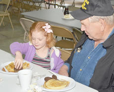 """<div class=""""source"""">Calen McKinney</div><div class=""""image-desc"""">Chloe Motheral, 6, and her step-great-grandfather Bobby Kessler, of Campbellsville, take a bite of their breakfast.</div><div class=""""buy-pic""""><a href=""""/photo_select/44064"""">Buy this photo</a></div>"""