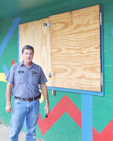 """<div class=""""source"""">Leslie Moore</div><div class=""""image-desc"""">Park supervisor Bill Brewer stands in front of plywood covering Miller Park's concessions building after the windows were broken.</div><div class=""""buy-pic""""><a href=""""/photo_select/45715"""">Buy this photo</a></div>"""
