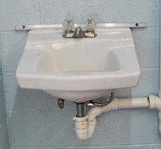 """<div class=""""source"""">Leslie Moore</div><div class=""""image-desc"""">Steel strips were installed to keep vandals from ripping sinks from the walls.</div><div class=""""buy-pic""""><a href=""""/photo_select/45716"""">Buy this photo</a></div>"""