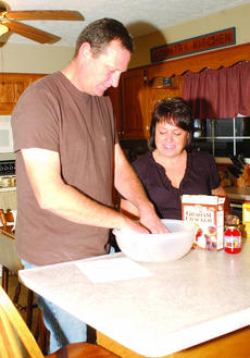 "<div class=""source"">Neila Schuhmann</div><div class=""image-desc"">Pat and Ema Hardesty prepare to make a fruitcake, their family's annual holiday tradition.</div><div class=""buy-pic""><a href=""/photo_select/20411"">Buy this photo</a></div>"