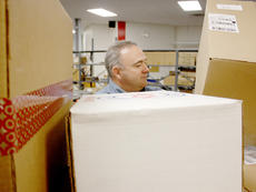 """<div class=""""source"""">Brent Schanding</div><div class=""""image-desc"""">Jim Smith, acting supervisor at the Campbellsville United States Postal Service, sorted boxes at the local branch. The local post office is handling between 1,800-2,500 packages daily during the busy holiday season, including hundreds of letters to Santa Claus.</div><div class=""""buy-pic""""><a href=""""/photo_select/41555"""">Buy this photo</a></div>"""