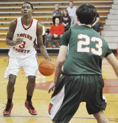 """<div class=""""source"""">Bobby Brockman</div><div class=""""image-desc"""">Quentin Goodin scored 31 points in Taylor County's triumph over Hart County.</div><div class=""""buy-pic""""><a href=""""/photo_select/42707"""">Buy this photo</a></div>"""