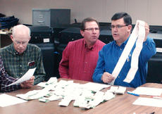 "<div class=""source"">James Roberts</div><div class=""image-desc"">Election officers Phil Alan Bertram, Allen Dudgeon and County Clerk Mark Carney check tapes during a recanvass Friday.</div><div class=""buy-pic""><a href=""http://web2.lcni5.com/cgi-bin/c2newbuyphoto.cgi?pub=085&orig=Recanvass_0006.jpg"" target=""_new"">Buy this photo</a></div>"