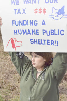 """<div class=""""source"""">Calen McKinney</div><div class=""""image-desc"""">Shawn Moffitt was one of two Campbellsville residents who spearheaded a protest on Tuesday at the Taylor County Animal Shelter. </div><div class=""""buy-pic""""><a href=""""http://web2.lcni5.com/cgi-bin/c2newbuyphoto.cgi?pub=085&orig=Shelter%2BProtest%2B7_0.jpg"""" target=""""_new"""">Buy this photo</a></div>"""