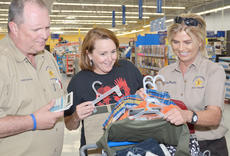 "<div class=""source"">Calen McKinney</div><div class=""image-desc"">Court security officers Terry McQueary, at left, and Lisa Bagby, far right, along with McQueary's wife, Beverly, center, help total the cost of a young boy's new clothing. McQueary and Bagby, members of Central Kentucky Fraternal Order of Police Lodge #22, are two of several law enforcement officers who helped children shop for new school clothes on Thursday. FOP raised $5,000 to help children buy new clothes and supplies.</div><div class=""buy-pic""><a href=""/photo_select/46286"">Buy this photo</a></div>"