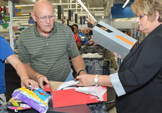 "<div class=""source"">Calen  McKinney</div><div class=""image-desc"">FOP members Paul Lacy and Patricia Thompson, who work in court security and as a captain at Campbellsville Police, respectively, place a young girl's new clothing in bags.</div><div class=""buy-pic""><a href=""/photo_select/46288"">Buy this photo</a></div>"