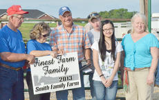 "<div class=""source"">Calen McKinney</div><div class=""image-desc"">The Smith family receives the Finest Farm Family award at the Taylor County Fair from fair board members.</div><div class=""buy-pic""><a href=""/photo_select/45254"">Buy this photo</a></div>"